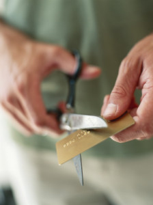 Man cutting up credit card,